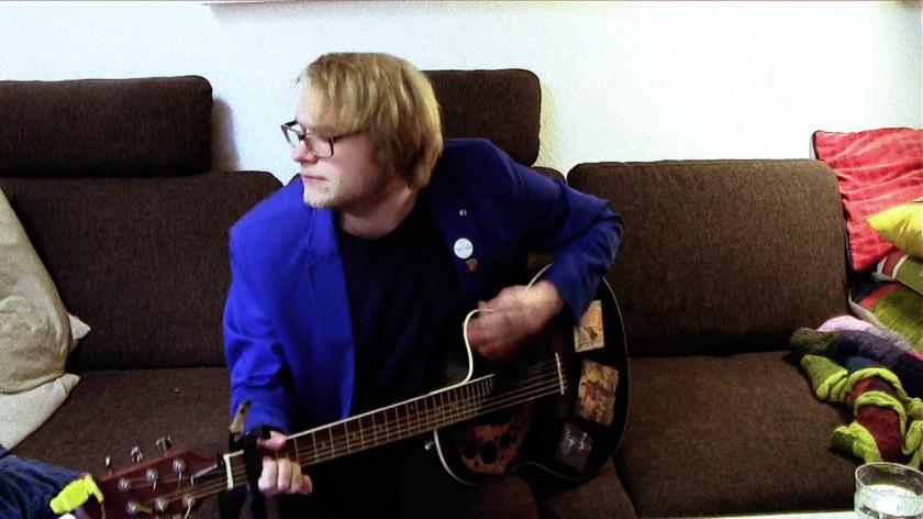 2.12 kai danzberg playing guitar